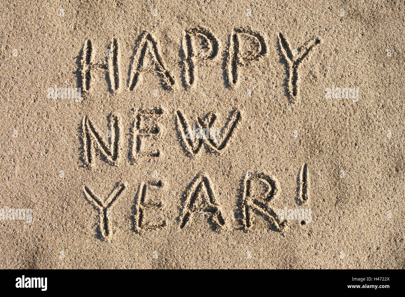 Happy new year! writing on the sand. - Stock Image