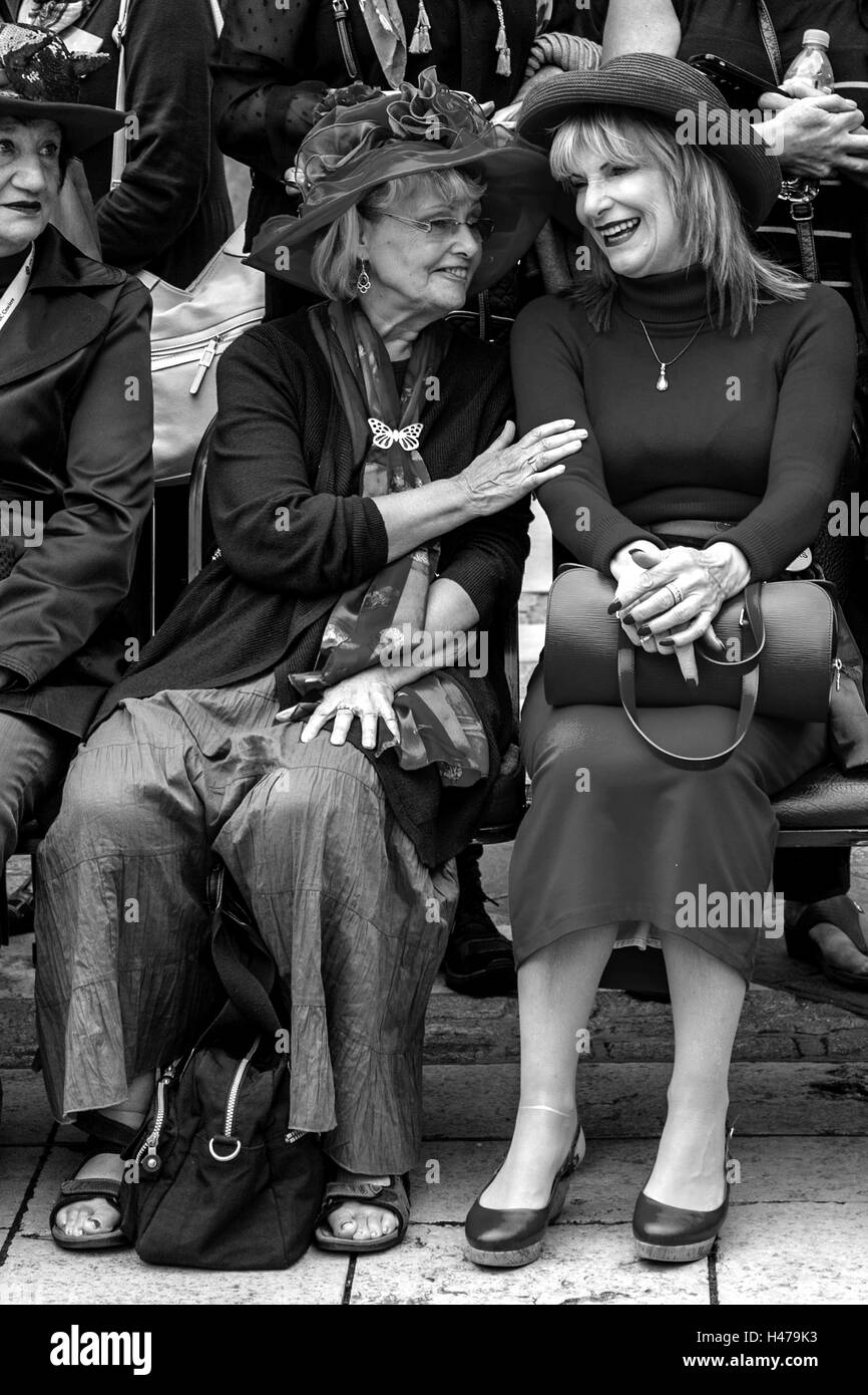 Two Women From The London Red Hatters Group Chatting At The Pearly Kings and Queens' Harvest Festival, London, - Stock Image