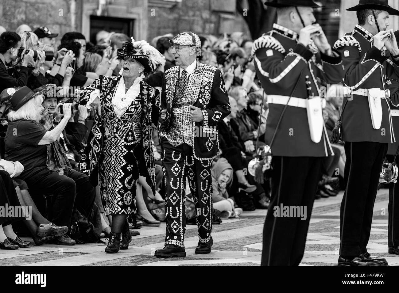 Pearly Kings and Queens Sing Traditional Songs At They Parade Around The Guildhall Yard, London, England - Stock Image