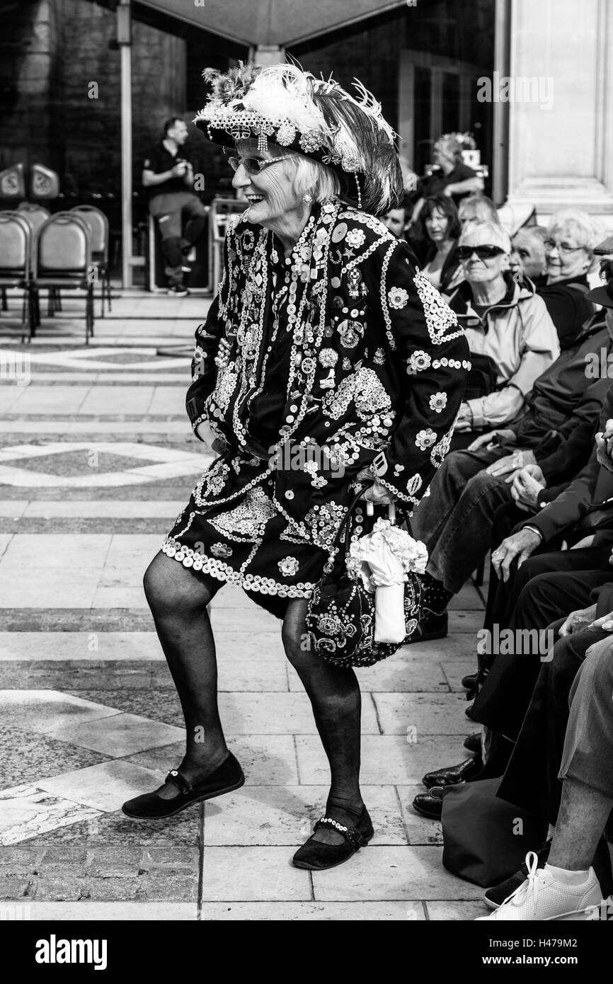 A Pearly Queen Does A Jig At The Pearly Kings and Queens' Harvest Festival, Held Annually At The Guildhall Yard, - Stock Image