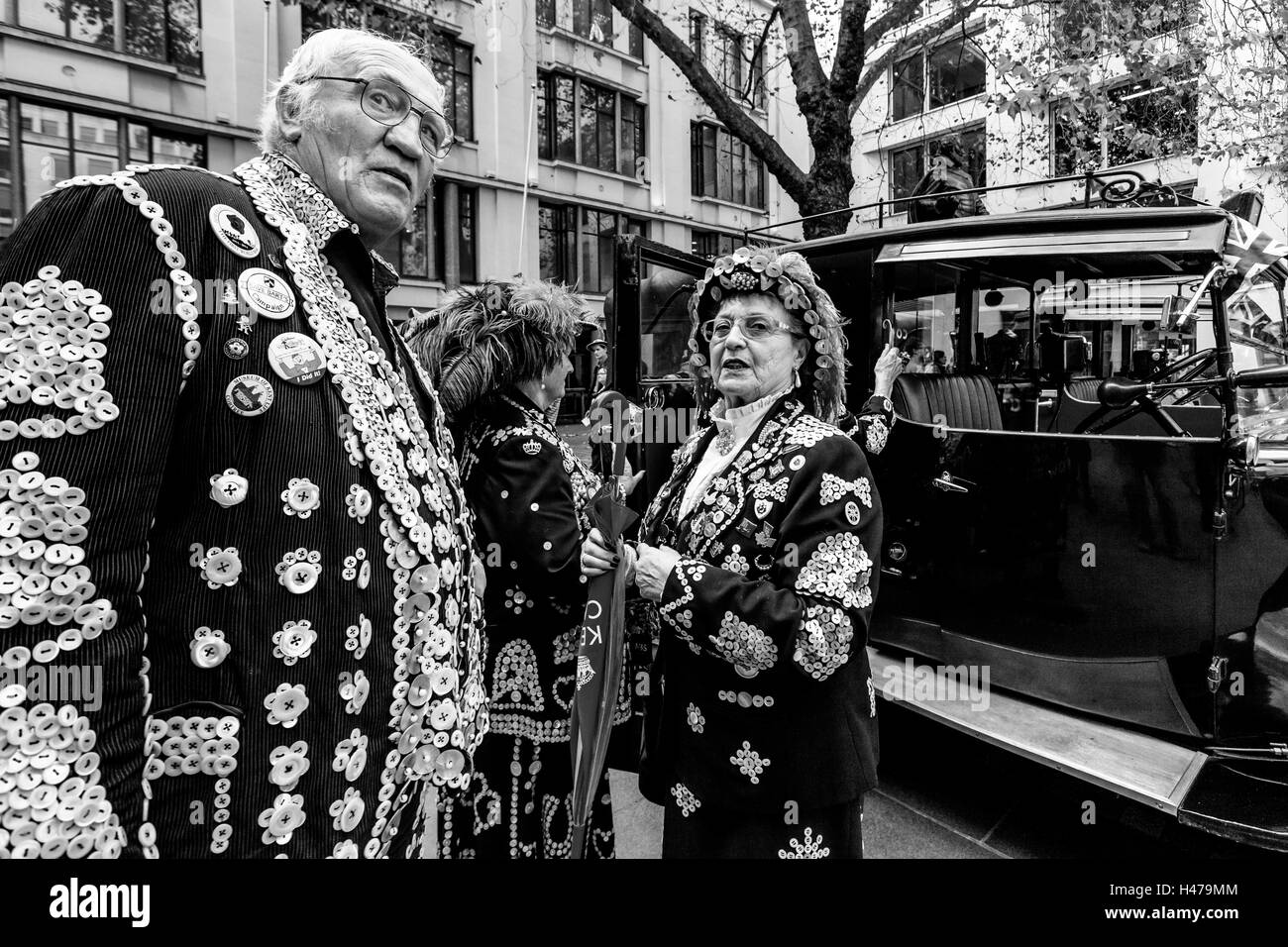 Pearly Kings and Queens Outside The Church Of St Mary-le-Bow (Bow Bells) After The Harvest Festival, London, England - Stock Image