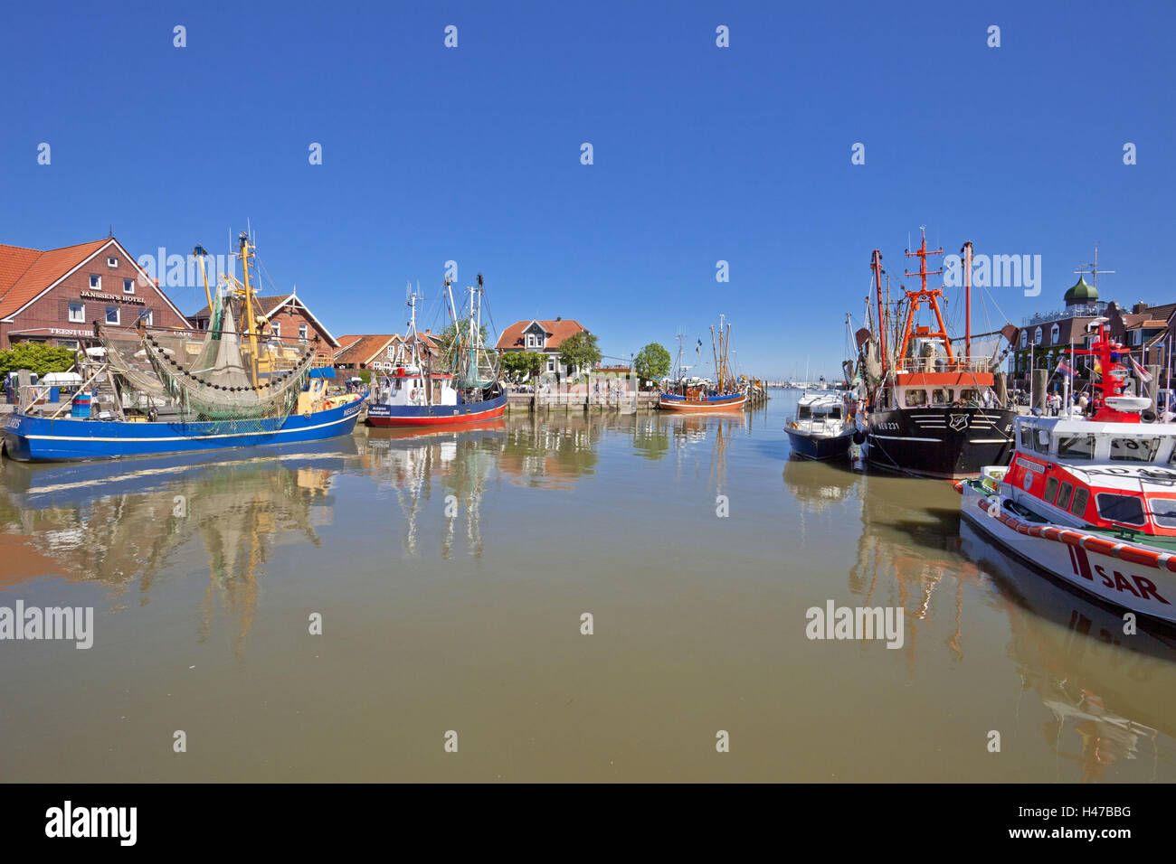 Crab cutters in the harbour Neuharlingersiel, - Stock Image