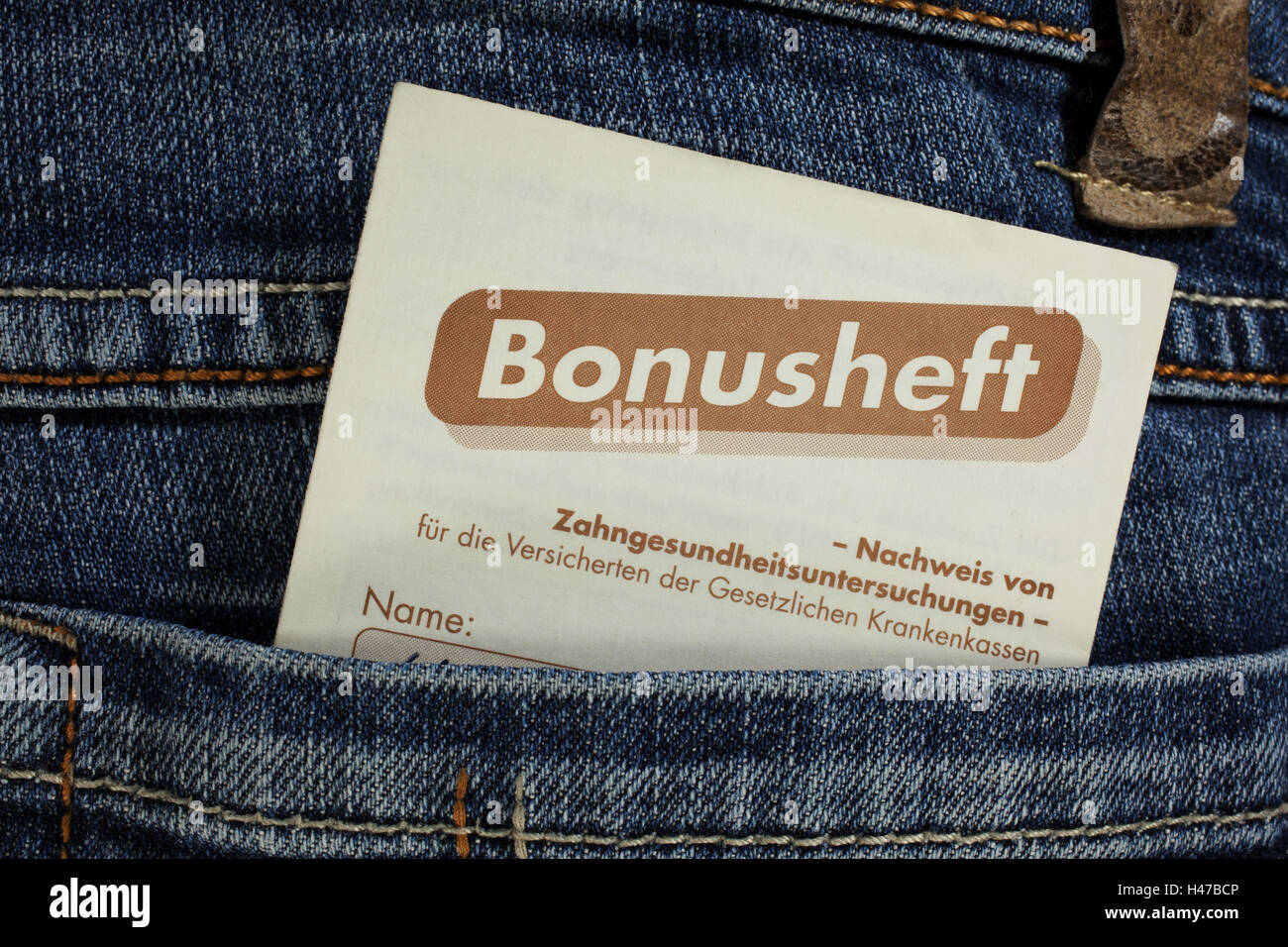 Cog-medical bonus notebook in a jeans pouch, - Stock Image
