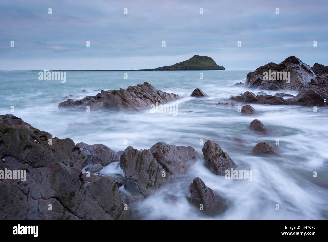 Rocky coast of the Gower looking towards Worm's Head, South Wales, UK. Winter (December) 2014. - Stock Image