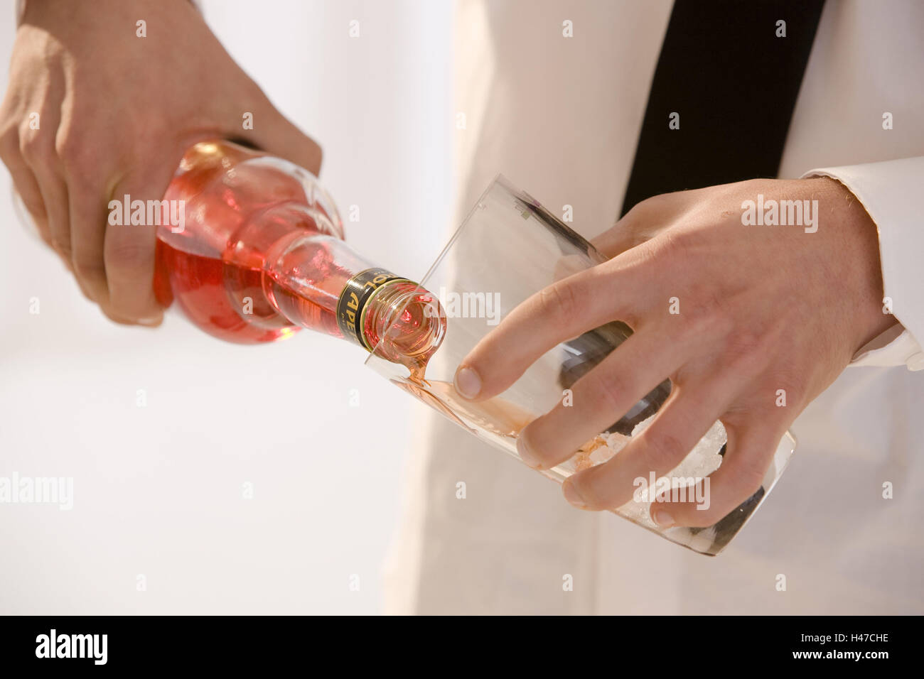 Barkeepers, detail, hands, glass, Aperol, fill, Stock Photo