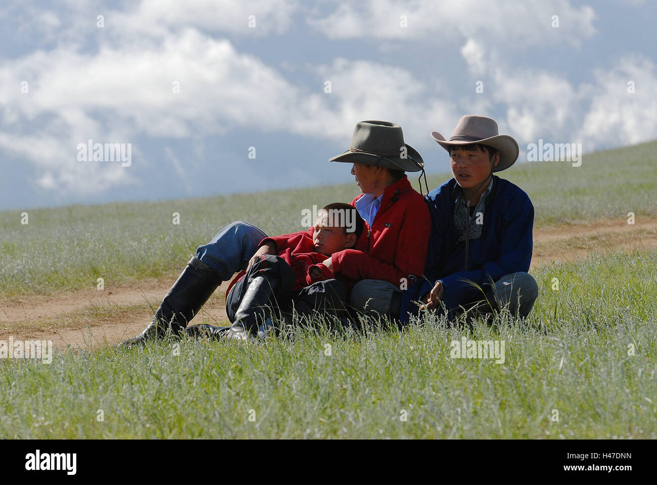Mongolia, pasture, cowboys, three, sit, pay attention, no model release, person, locals, Mongols, adults, father, - Stock Image