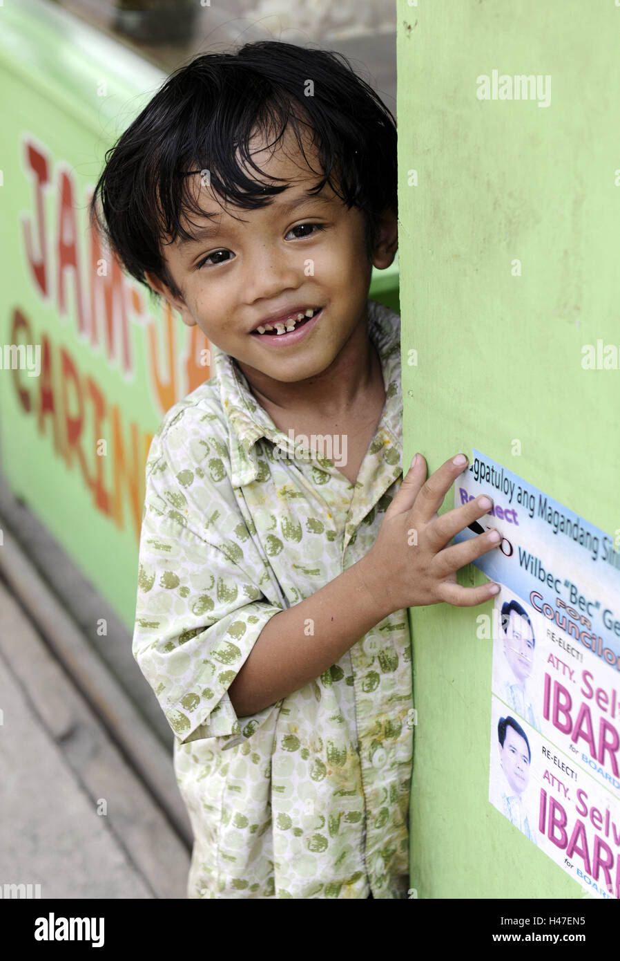 The Philippines, boy, cogs, boy, person, child, tooth gaps, laugh, happy, hand, wall, Asian, portrait, Asia, - Stock Image