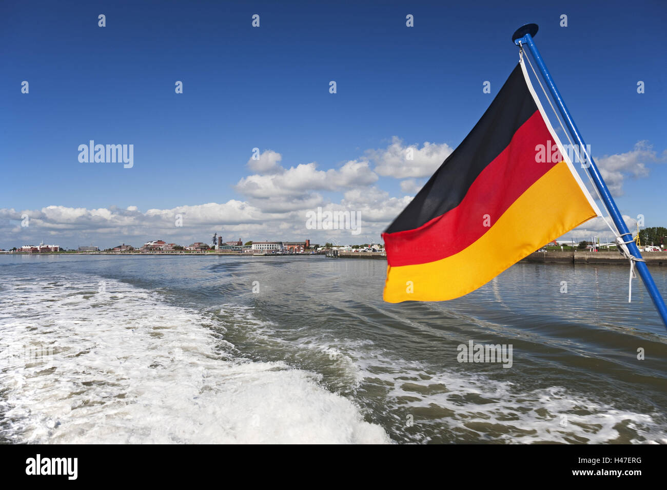 Germany, Wilhelmshaven, Germany flag on holiday ship MS Harle Courier, - Stock Image