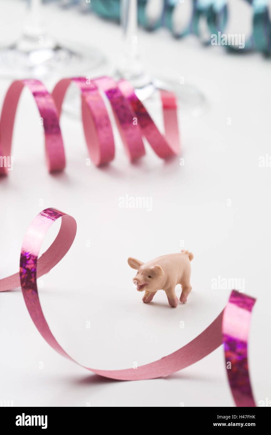 Lucky pig between streamers, - Stock Image