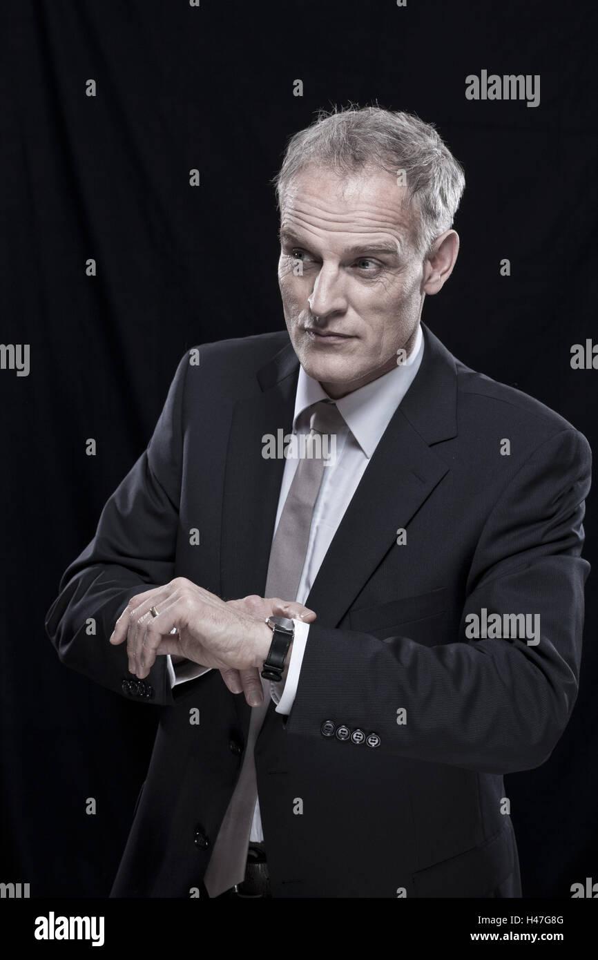 Businessman, haste, date, view wristwatch, half portrait, - Stock Image
