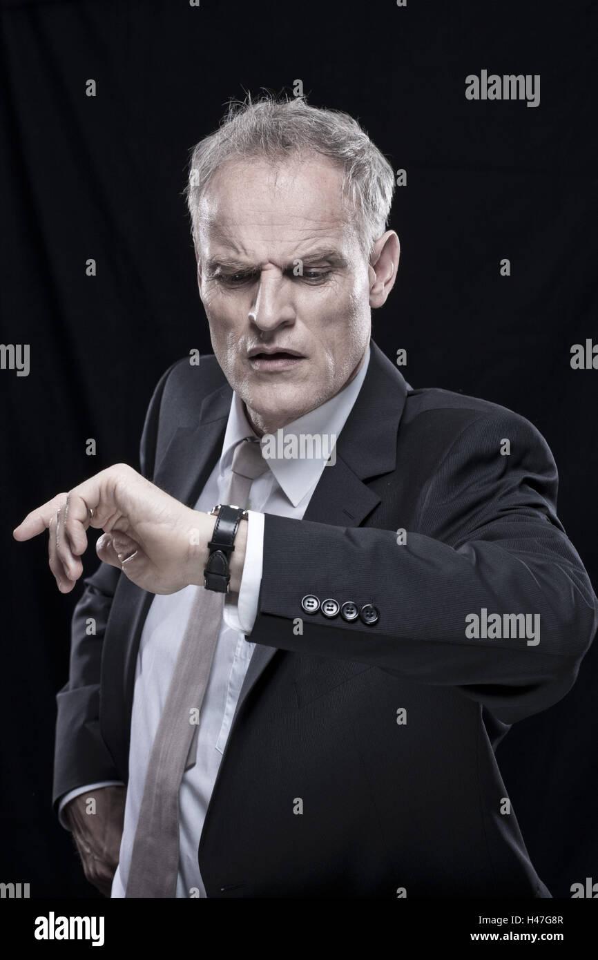 Businessman, haste, date, view on wristwatch, portrait, - Stock Image