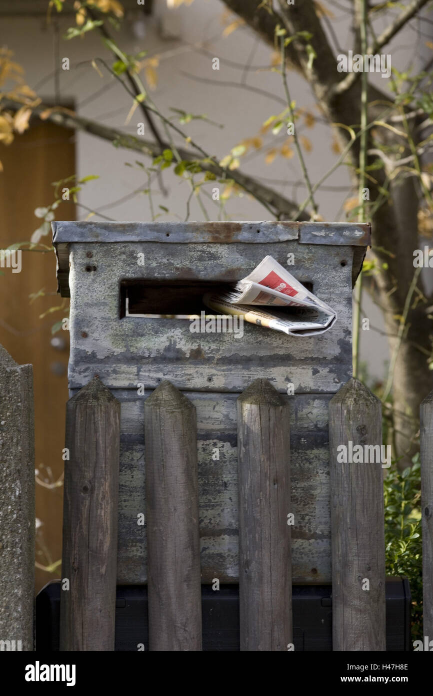 rusted mailbox with newspaper, - Stock Image