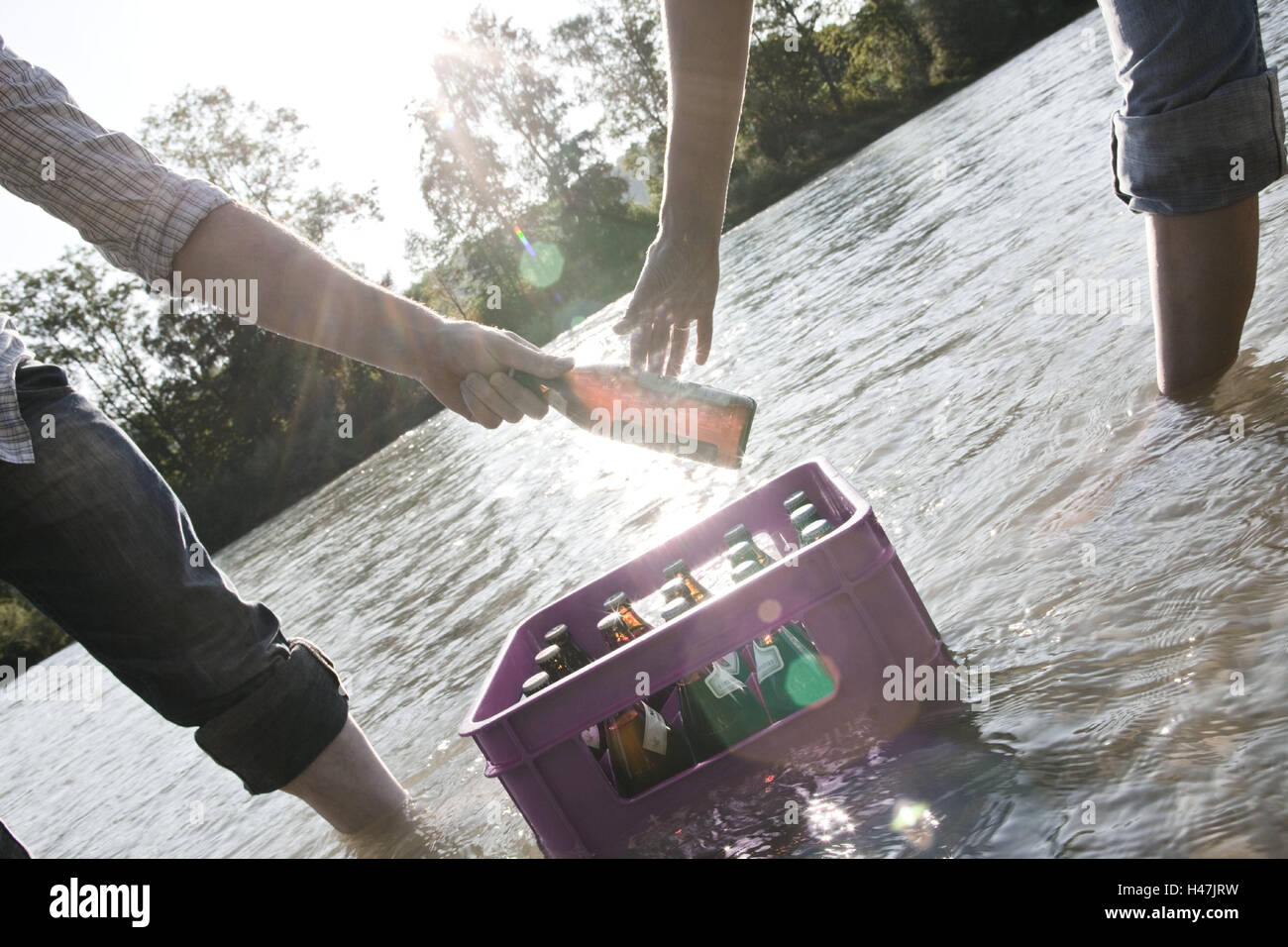 Beer crate, cooling, water, men, two, cases, beer, alcohol, beer Stock  Photo - Alamy