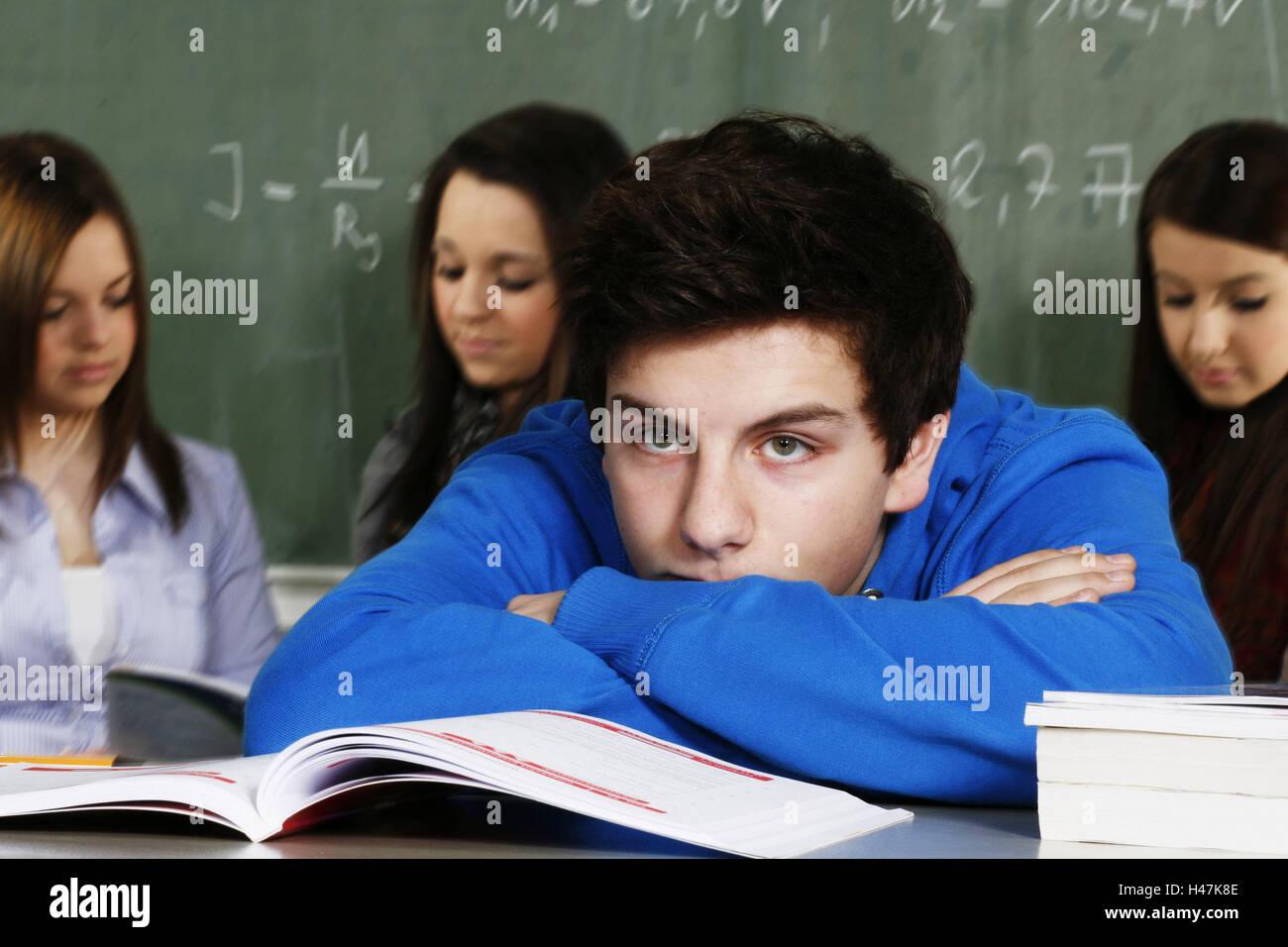 School, classroom, schoolboys, schoolgirls, blackboard, sitting, resting, head, view, boredom, concentration, books, - Stock Image