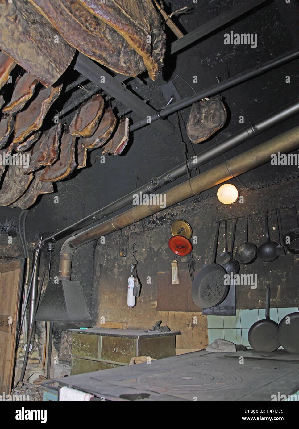 Smoke cuisine, old, ham, hangs, Italy, South Tyrol, Ultental, Ulten, cuisine, focus, kiln, iron, iron, hearthstone, - Stock Image