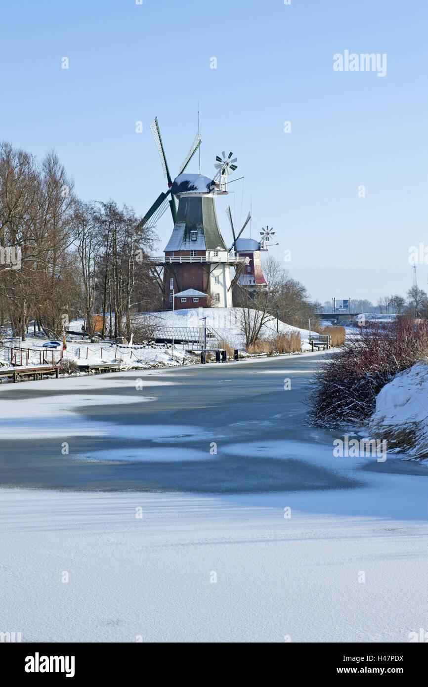 Winter mood, twin's mills in Greetsiel, - Stock Image