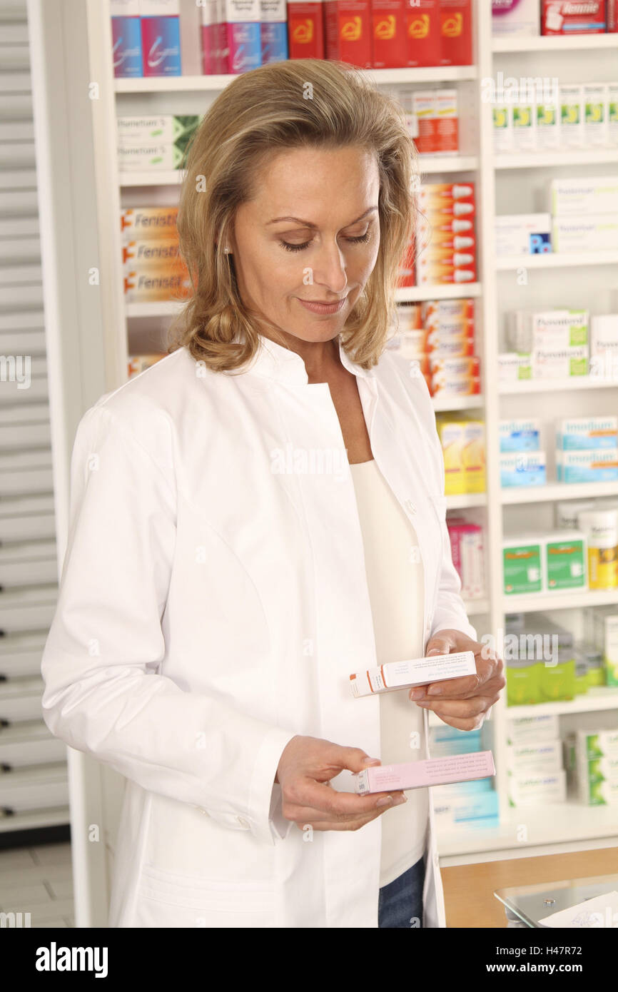 Pharmacist considered pharmaceuticals, - Stock Image