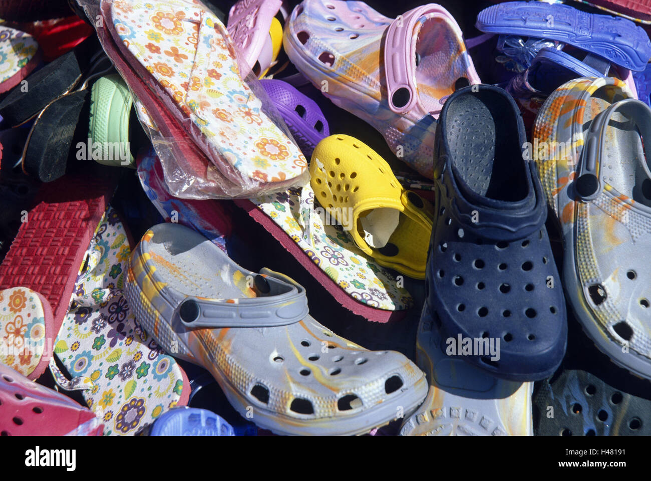 Summer shoes, brightly, sales, Italy, island, Sardinia, shoes, summer shoes, shoes, flip flops, Crocs, sales, plastic - Stock Image