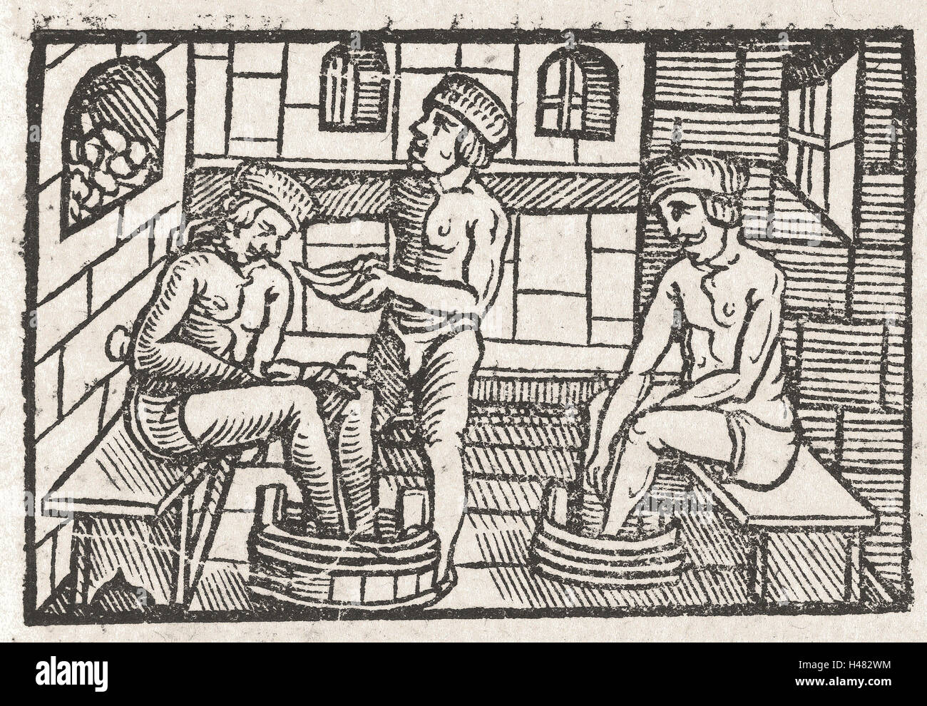 Woodcut illustration and text from book on anatomy - Stock Image