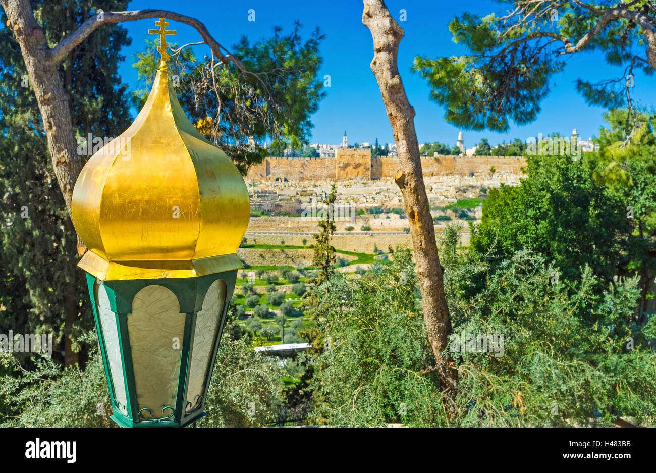 The lantern in front of the Russian Orthodox Church of Mary Magdalene with the medieval walls of Jerusalem on the Stock Photo