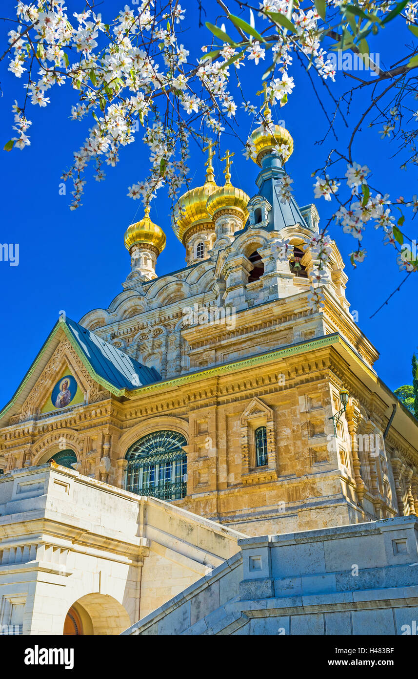 The scenic Russian Orthodox Church and the branches of the blossom tree, Israel. - Stock Image