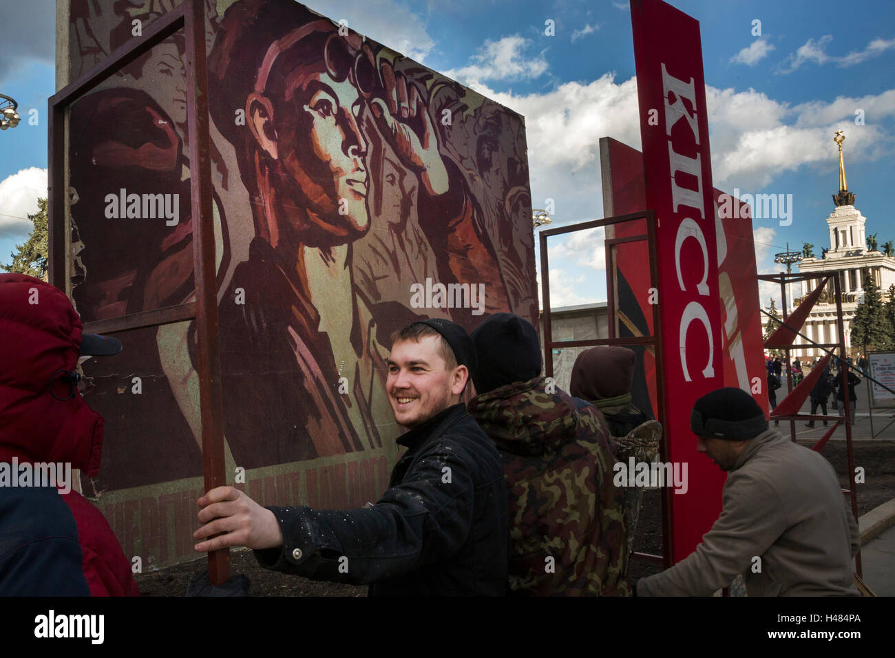 Workers install soviet placards at central avenue of the VDNKh the All-Russia Exhibition Centre in Moscow, Russia - Stock Image