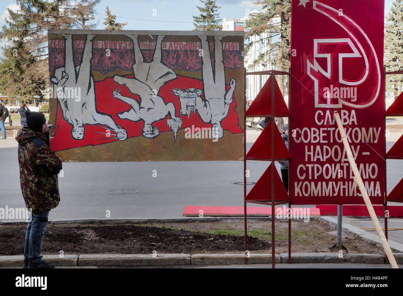 A man holds posters of the Soviet era in the VDNKh All-Russia exhibition in Moscow, Russia - Stock Image