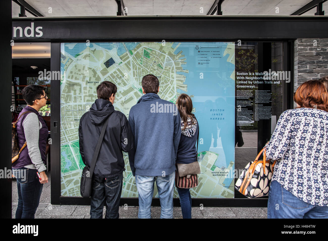 People standing in front of tourist city map, boston - Stock Image