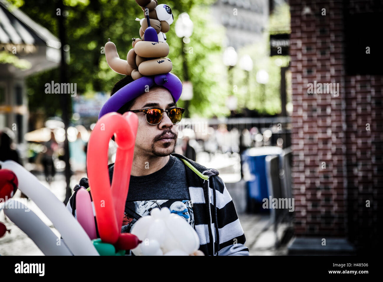 Balloon man in Quincy Market, Boston - Stock Image