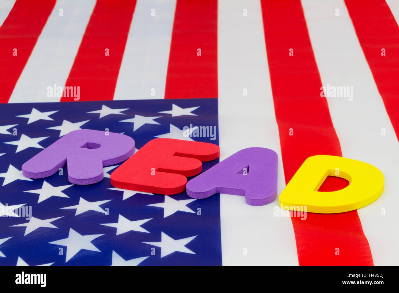 READ word on American flag emphasizes national education policy highlighting literacy and accountability. - Stock Image