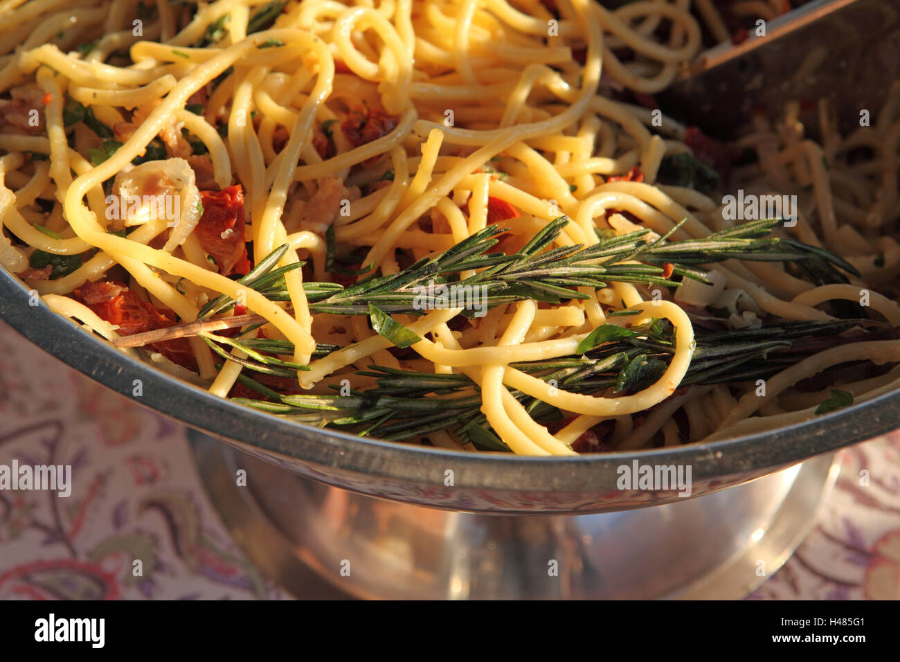 Garden party, bowl with pasta salad in the evening light Stock Photo ...