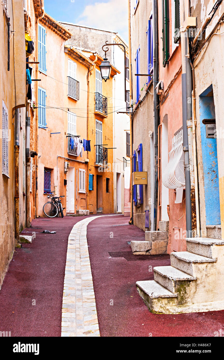 The old city of Cannes is located on the hill and contains of such quiet streets, France. - Stock Image