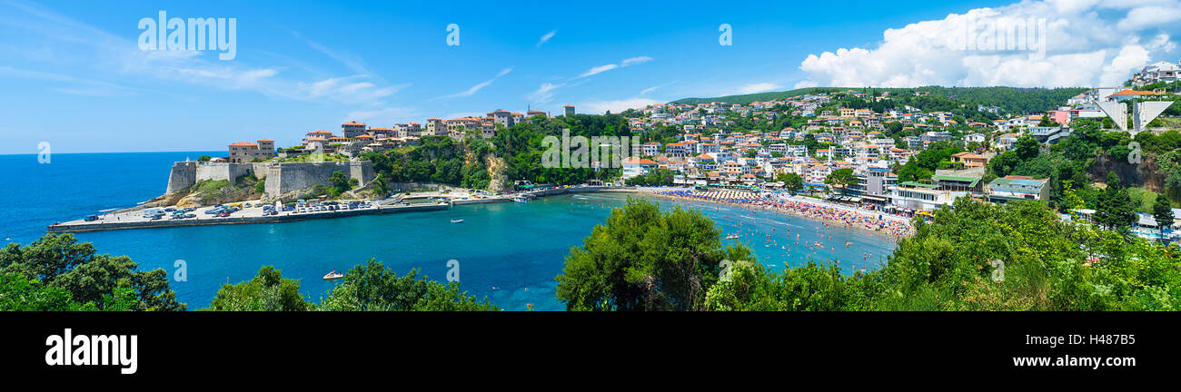 The old town of Ulcinj with the Kalaja castle neighboring with the central beach, Montenegro. - Stock Image