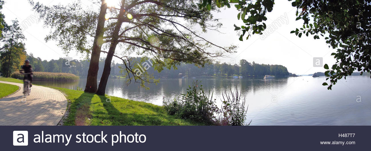 Sea promenade in bath Saarow in the skirmish lake, morning light, summer, cyclist, boots on the lake, - Stock Image
