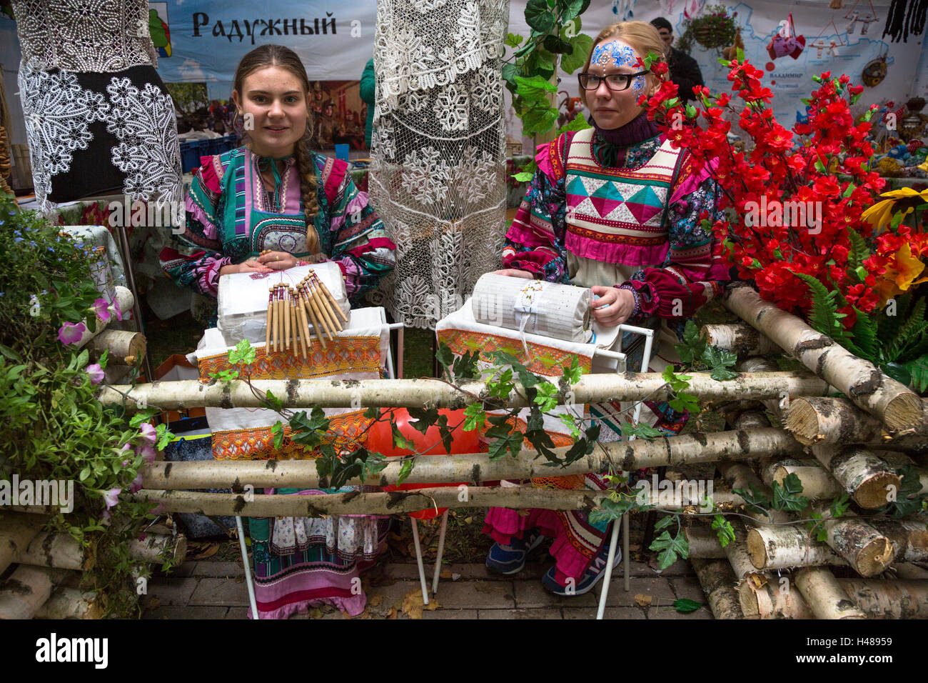 Skilled girls waving the traditional bobbin lace in Vladimir town, Russia - Stock Image
