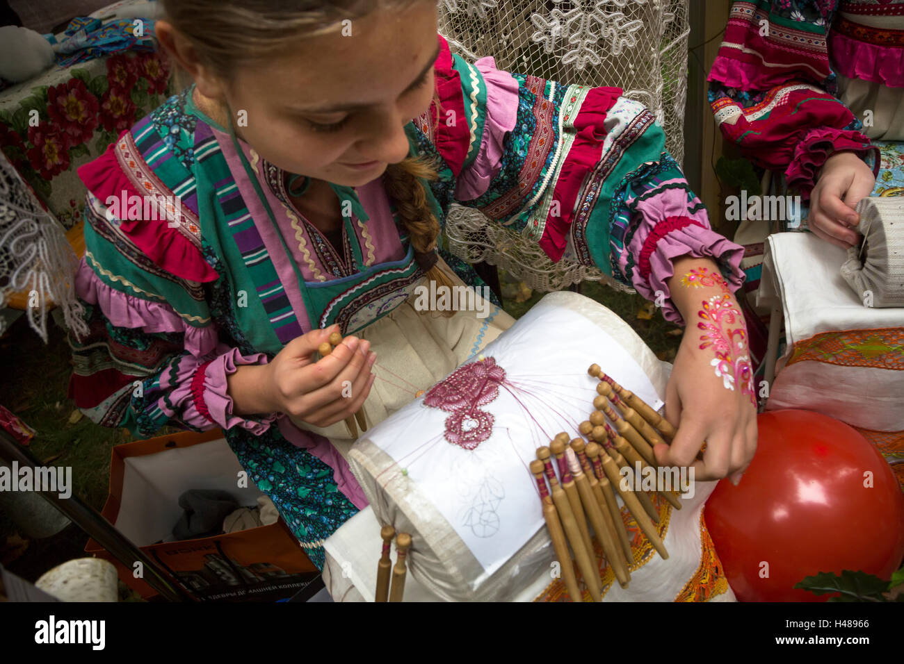 Skilled girl waving the traditional bobbin lace in Vladimir town, Russia - Stock Image
