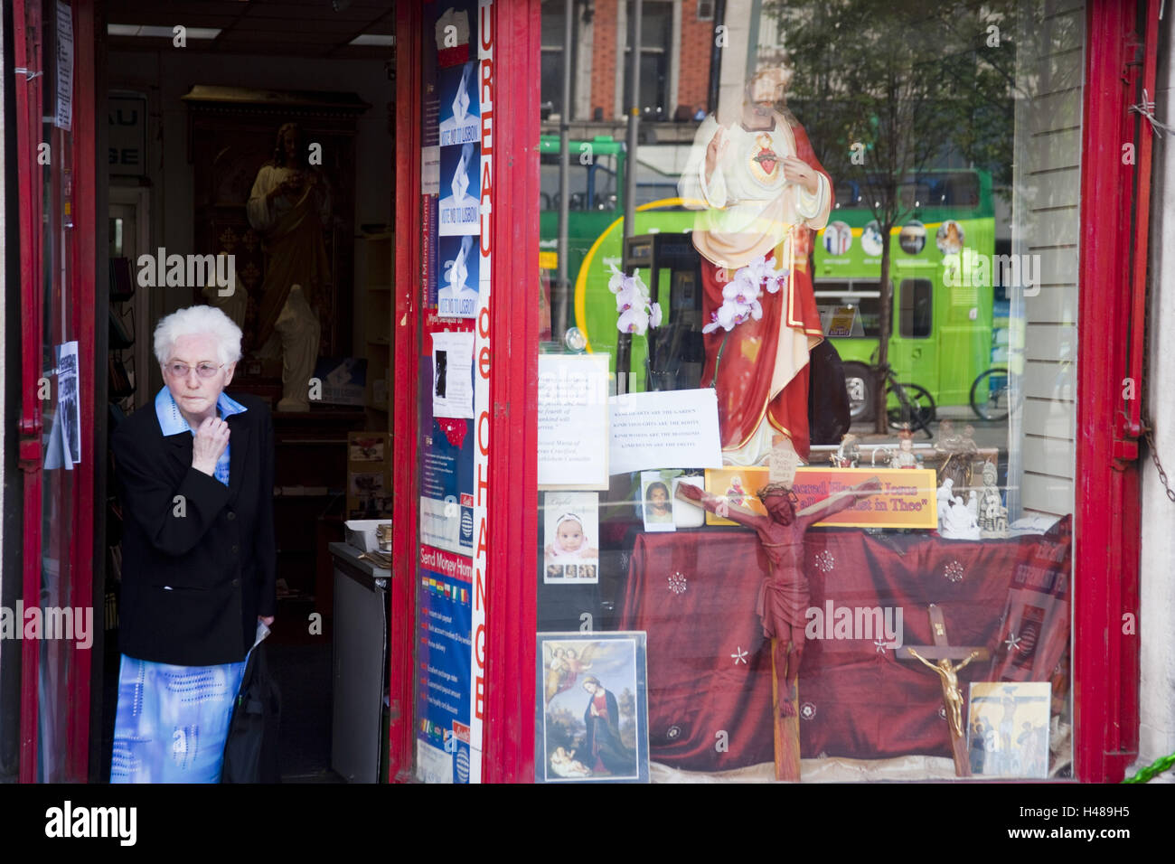 Ireland, Dublin, city centre, O'Connell Street, shop, devotional objects, woman, - Stock Image