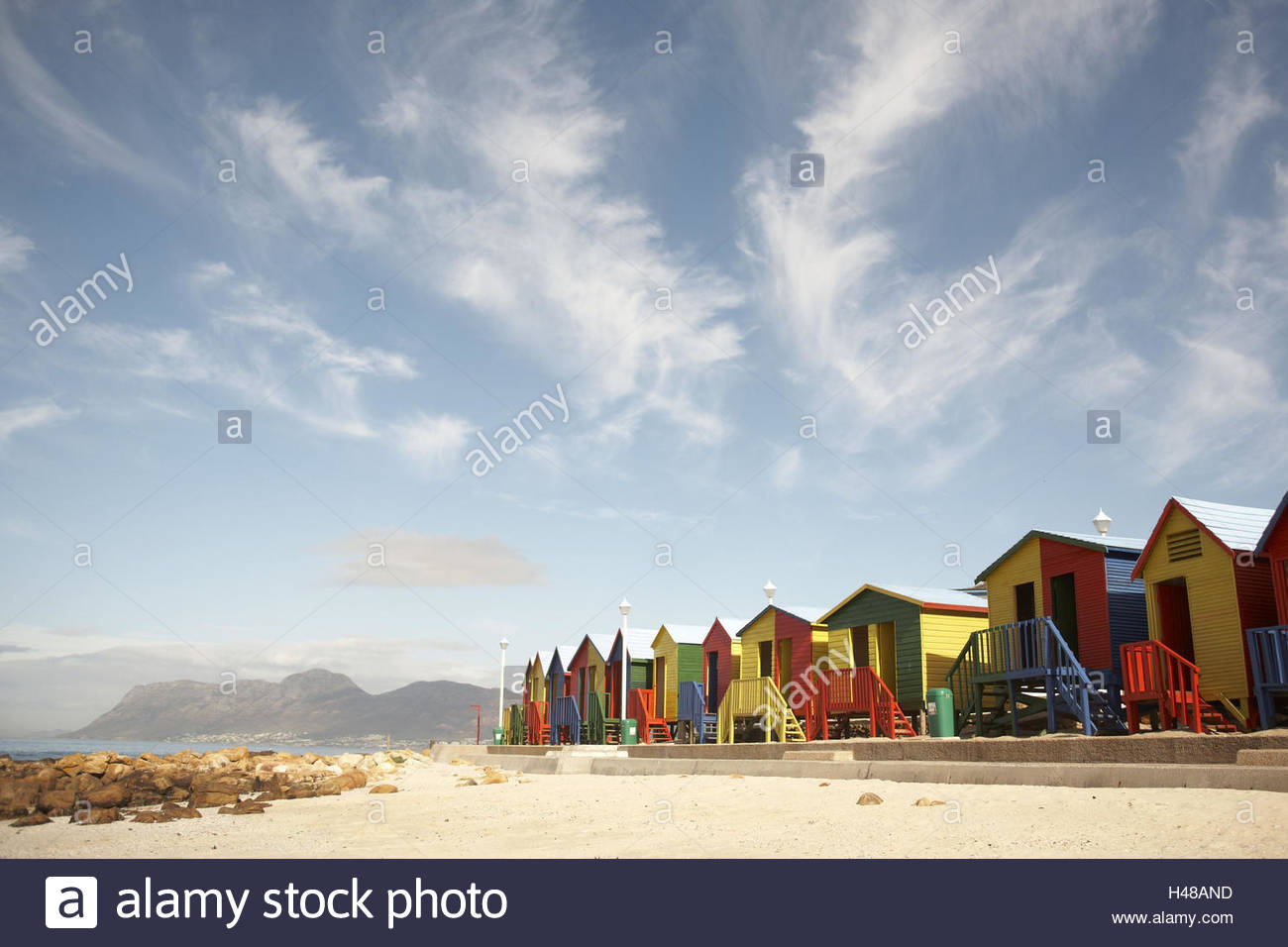Africa, South Africa, Western Cape, False Bay, close Capetown and Muizenberg, St. James, coloured beach huts, sunny - Stock Image