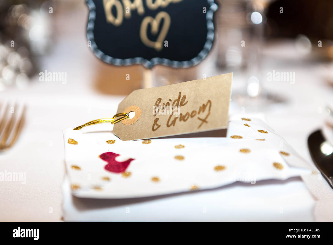 Place Setting For The Bride And Groom On A Wedding Table   Stock Image