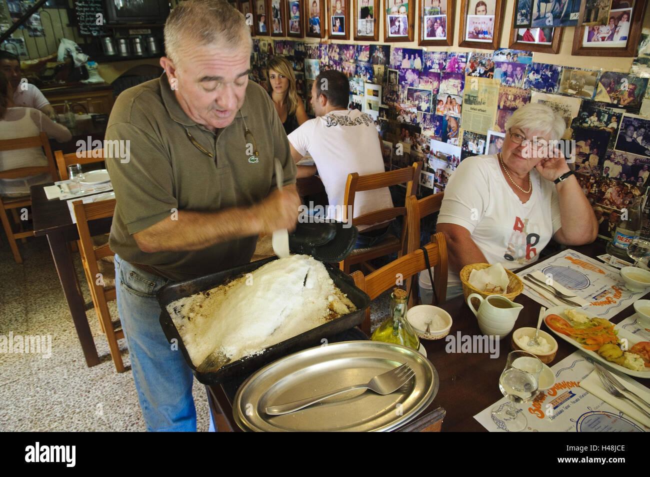 Restaurant 'Casa of Manolo', Manolo serves fish in salt crust, Ses Salines, Majorca, Spain, - Stock Image