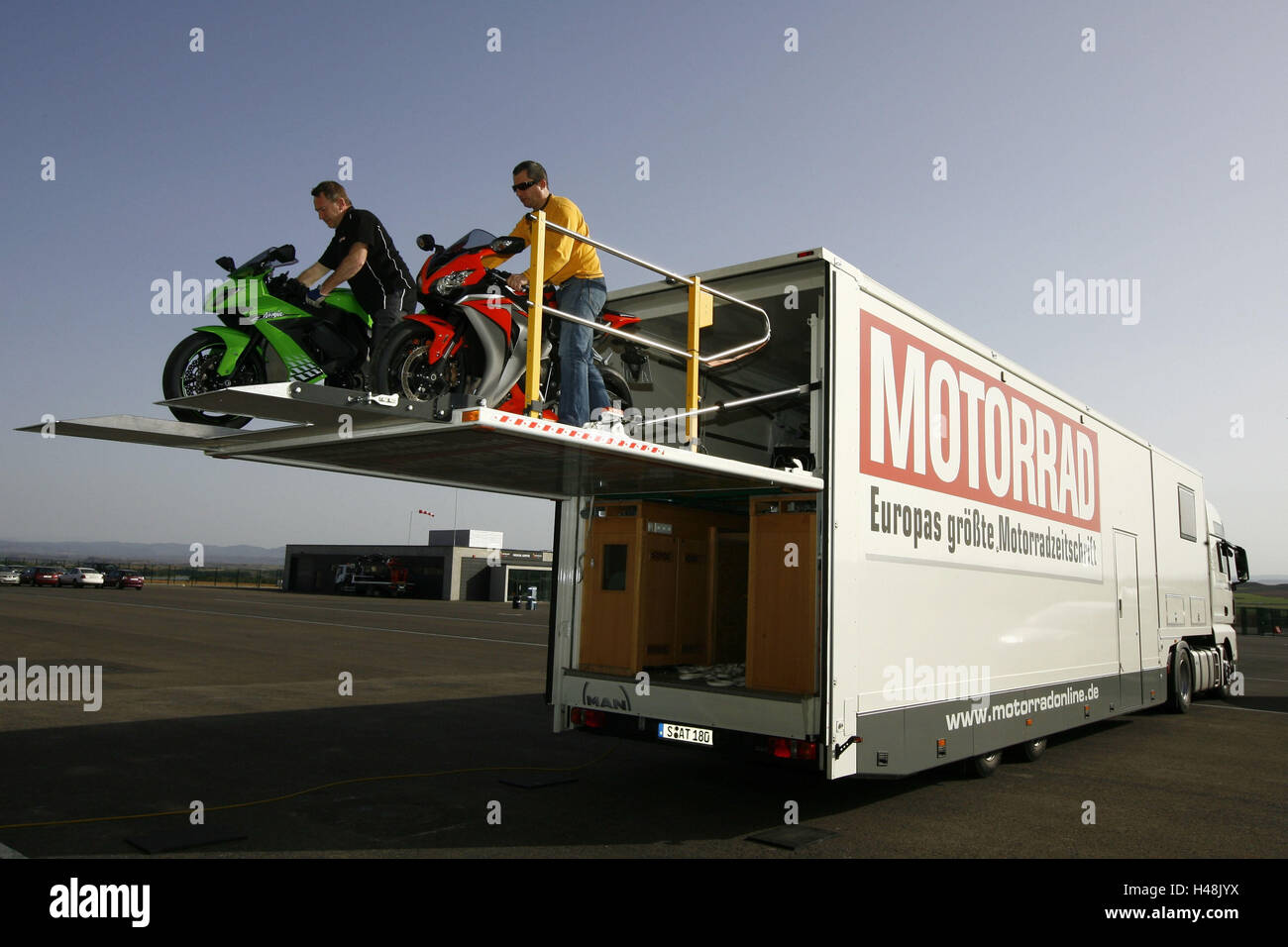 Motorcycle transport, truck, motorcycles, unloading, - Stock Image