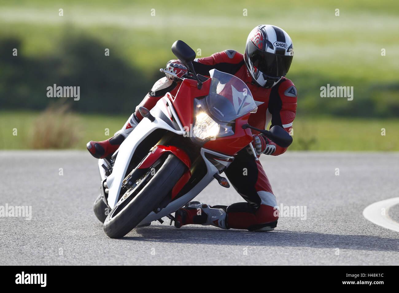 Motorcycle, Honda CBR 600 F, curve, tilt, moving, head-on, knee on ground, - Stock Image