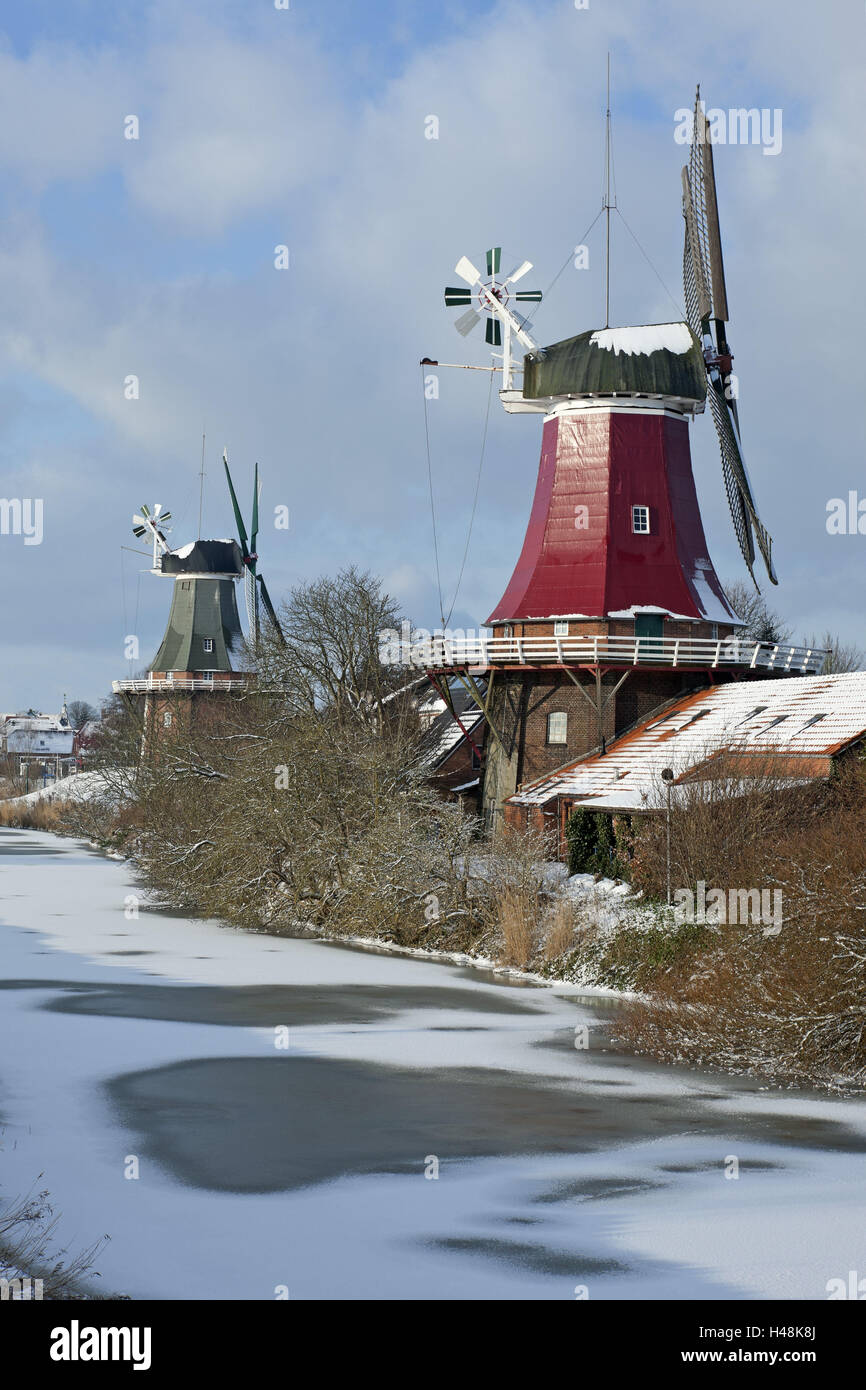 winter mood, twin's mills in Greetsiel (village), - Stock Image