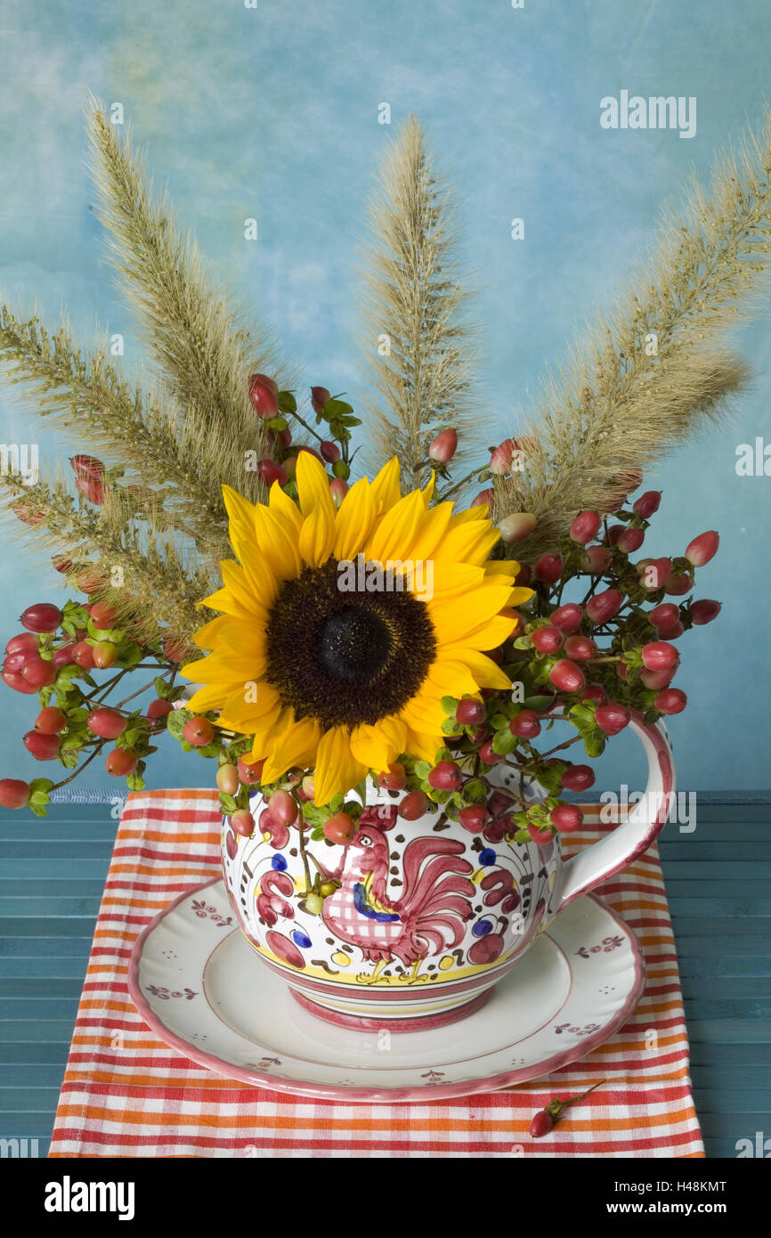 Autumn bouquet in the jug on blue table, - Stock Image