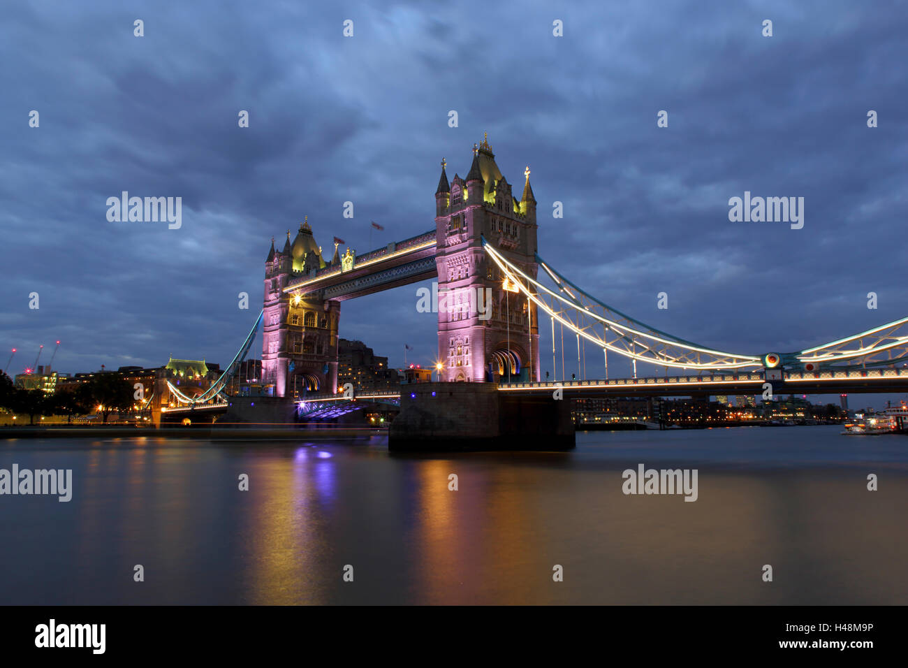 Tower Bridge London lit with purple lighting - Stock Image