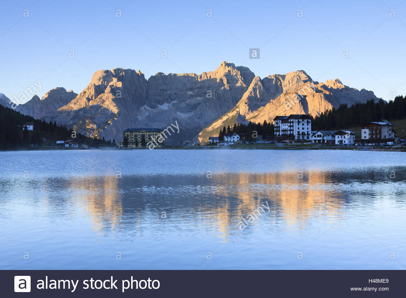 Mountain hotels at the Lago Misurina, Lake Misurina, in front of the massif of the Sorapis at sunrise, Italy, Trentino, - Stock Image