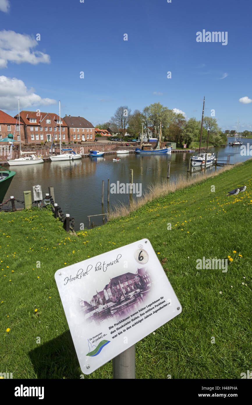 Sign 'Hooksiel Historically', in the historical 'old harbour' from Hooksiel, Germany, Lower Saxony, - Stock Image
