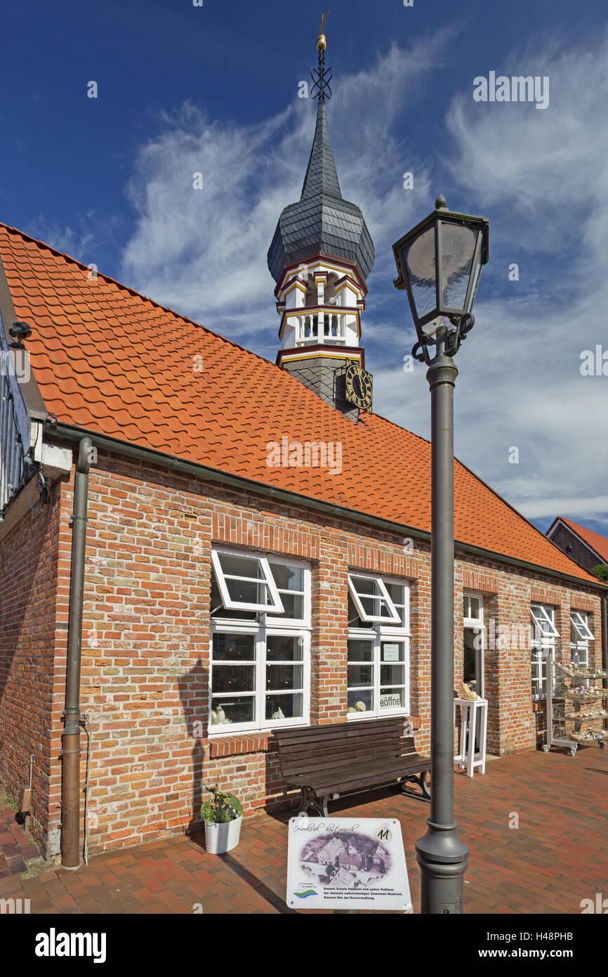 Sign 'Hooksiel Historically', Hooksieler mussel museum with bulbous spire, early artist's house, school, - Stock Image