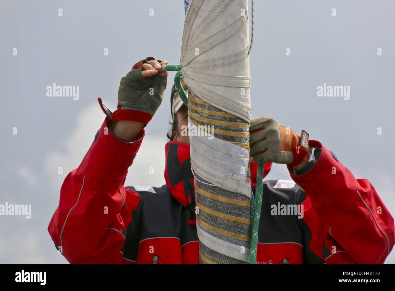 Sailboats, man, head sail, detail, - Stock Image
