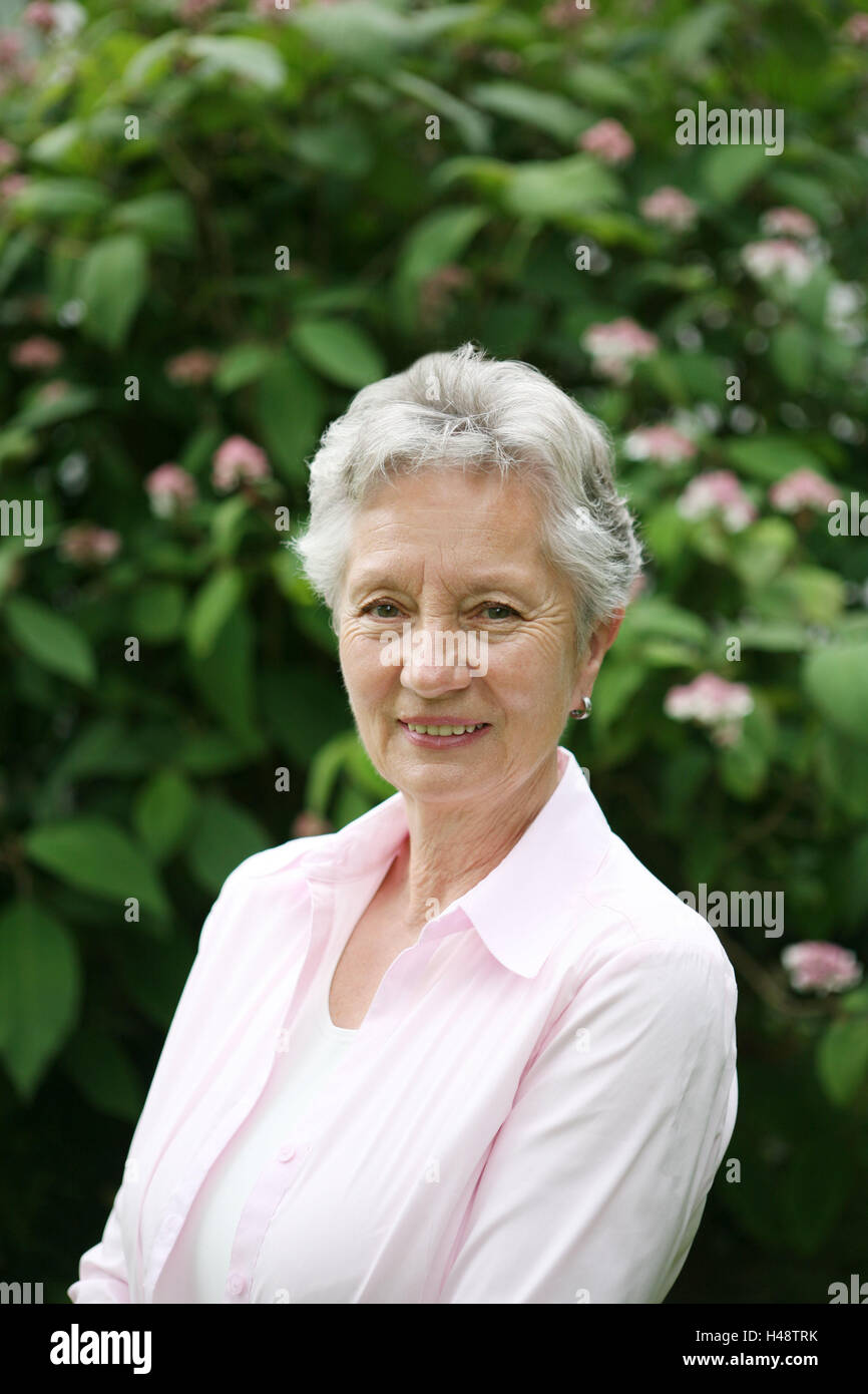 Garden, shrub, senior, smile, portrait, summer, person, woman, old, grey-haired, short hair hairstyle, pension, - Stock Image